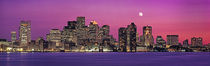 USA, Massachusetts, Boston, View of an urban skyline by the shore at night by Panoramic Images