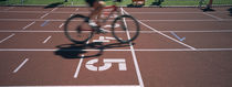 Low section view of a man cycling on sports track, Kirchzarten, Germany by Panoramic Images