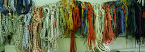 Colorful braided ropes for sailing in a store by Panoramic Images