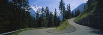 Empty road passing through mountains, Bernese Oberland, Switzerland by Panoramic Images