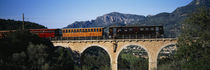 Train crossing a bridge, Sierra De Tramuntana, Majorca, Spain von Panoramic Images
