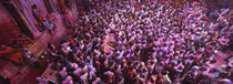High angle view of people celebrating holi, Braj, Mathura, Uttar Pradesh, India von Panoramic Images