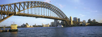 Australia, New South Wales, Sydney, Sydney harbor, View of bridge and city by Panoramic Images