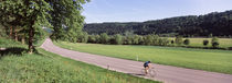 Cyclist moving on the road, Neckar Valley, Baden-Wurttemberg, Germany by Panoramic Images