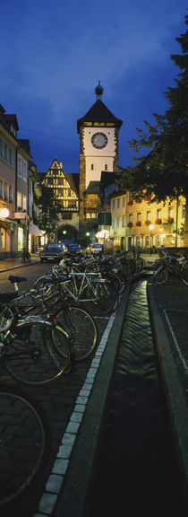 Bicycles parked along a stream near a road, Freiburg, Baden-Wurttemberg, Germany by Panoramic Images