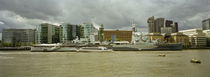 Buildings at the waterfront, Thames River, London, England by Panoramic Images