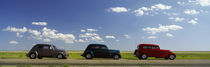 Three Hot Rods moving on a highway, Route 66, USA by Panoramic Images