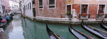 Gondolas in a canal, Grand Canal, Venice, Italy by Panoramic Images