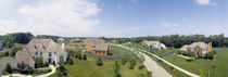High angle view of houses on a field by Panoramic Images