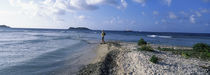 Tourist fishing on the beach, Sandy Cay, Carriacou, Grenada by Panoramic Images