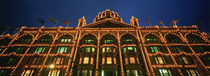 Low angle view of a building lit up at night, Harrods, London, England von Panoramic Images