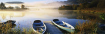 Rowboats at the lakeside, English Lake District, Grasmere, Cumbria, England von Panoramic Images