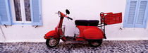 Motor scooter parked in front of a building, Santorini, Cyclades Islands, Greece by Panoramic Images
