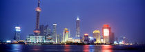 Buildings lit up at dusk, Shanghai, China by Panoramic Images
