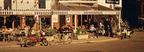 Tourists sitting in a cafe, Sitges Beach, Catalonia, Spain by Panoramic Images