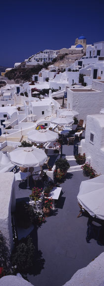 High angle view of chairs and tables in a balcony, Oia, Santorini, Greece by Panoramic Images