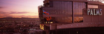 Hotel lit up at dusk, Palms Casino Resort, Las Vegas, Nevada, USA by Panoramic Images