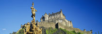 Low angle view of a castle on a hill, Edinburgh Castle, Edinburgh, Scotland by Panoramic Images