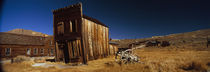 Abandoned buildings on a landscape, Bodie Ghost Town, California, USA by Panoramic Images