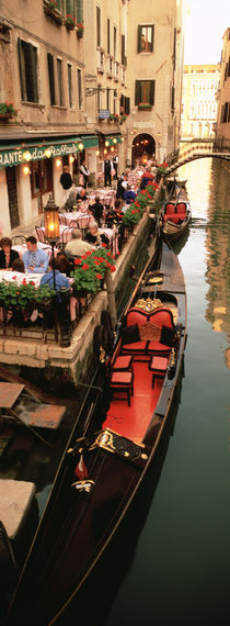 Gondolas moored outside of a cafe, Venice, Italy von Panoramic Images