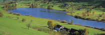 Lake Huttensee, Aerial view of cottages around a lake by Panoramic Images