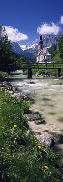 Bridge over stream below country church, Bavarian Alps, Germany. von Panoramic Images