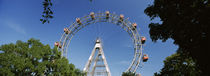 Ferris wheel in an amusement park, Prater Park, Vienna, Austria by Panoramic Images