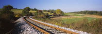 Railroad track passing through a landscape, Germany by Panoramic Images