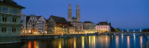 Buildings at the waterfront, Grossmunster Cathedral, Zurich, Switzerland by Panoramic Images