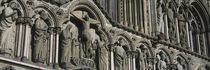 Low angle view of statues carved on wall of a cathedral, Trondheim, Norway by Panoramic Images