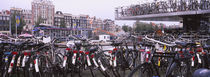 Bicycles parked in a parking lot, Amsterdam, Netherlands by Panoramic Images