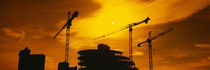 Silhouette of cranes at a construction site, London, England by Panoramic Images