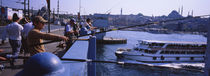 Side profile of fishermen fishing in a river, Galata Bridge, Istanbul, Turkey by Panoramic Images