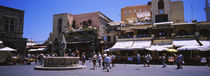 Tourists walking at a town square, Plateia Ippokratous, Rhodes, Greece von Panoramic Images