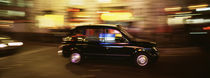 England, London, Black cab in the night von Panoramic Images