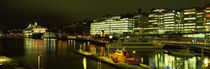 Buildings in a city lit up at night, Sodermalm, Slussplan, Stockholm, Sweden by Panoramic Images