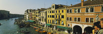 Tourists looking at gondolas in a canal, Venice, Italy by Panoramic Images