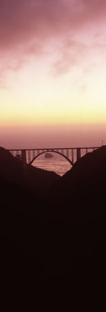 Silhouette of a bridge at sunset, Bixby Bridge, Big Sur, California, USA by Panoramic Images