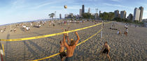 Four people playing beach volleyball, North Avenue Beach, Chicago, Illinois, USA by Panoramic Images