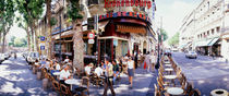 Group of people at a sidewalk cafe, Paris, France by Panoramic Images