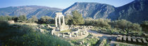 Greece, Delphi, The Tholos, Ruins of the ancient monument by Panoramic Images