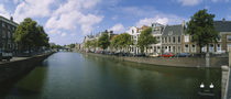 Buildings along a canal, Haarlem, Netherlands by Panoramic Images
