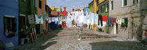 Clothesline in a street, Burano, Veneto, Italy by Panoramic Images