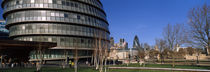 Buildings in a city, Sir Norman Foster Building, London, England by Panoramic Images
