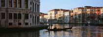 Man on a gondola in a canal, Grand Canal, Venice, Italy by Panoramic Images