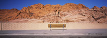 Bench in front of rocks, Red Rock Canyon State Park, Nevada, USA by Panoramic Images