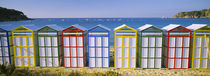 Beach huts in a row on the beach, Catalonia, Spain by Panoramic Images