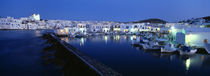 Buildings lit up at night, Paros, Cyclades Islands, Greece by Panoramic Images