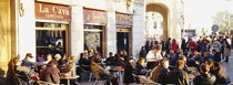 Tourists sitting outside of a cafe, Barcelona, Spain by Panoramic Images