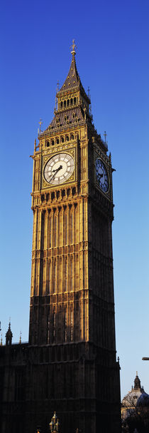 Low angle view of a clock tower, Big Ben, Houses of Parliament, London, England by Panoramic Images